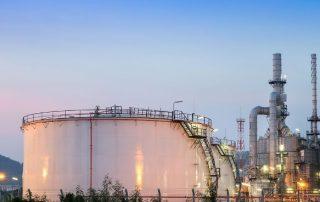 oil_and_gas_white_oil_tanks_at_dusk