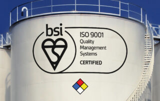ISO-9001-trust-mark-for-reynolds-training-displayed-on-the-side-of-a-bulk-storage-tank-with-the-reynolds-diamond